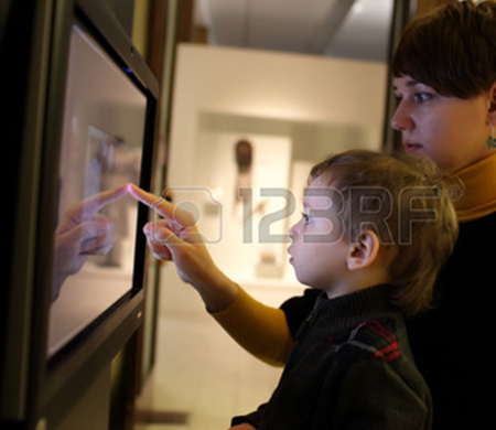29605463-mother-and-her-son-using-touch-screen-in-a-museum-r